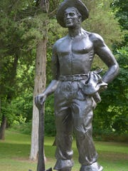 A bronze statue of a Civilian Conservation Corps member