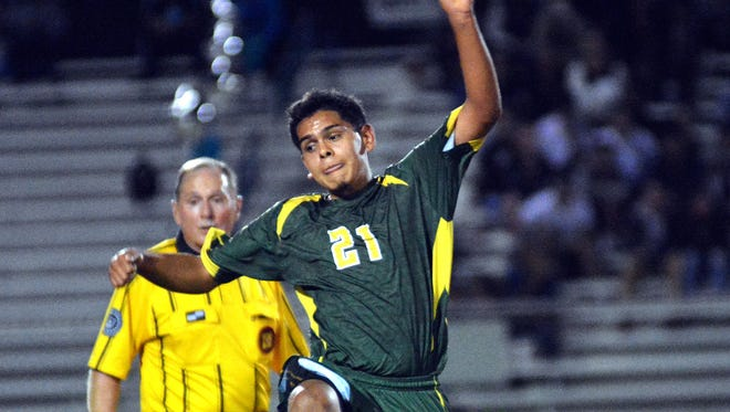 Mayfield's Arturo Carrasco goes up for the ball during Thursday night's action against Oñate High.