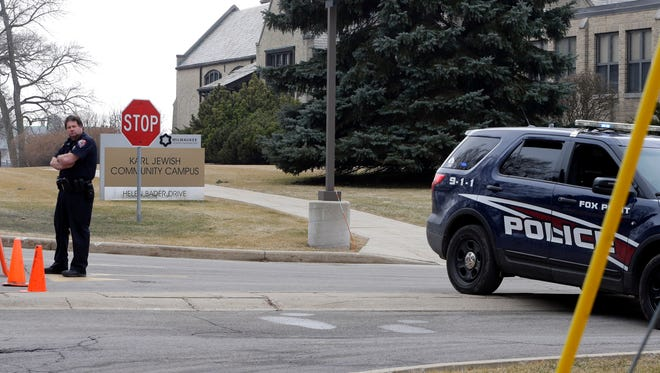 A police officer stands near  The Harry & Rose Samson Family Jewish Community Center, 6255 N. Santa Monica Blvd. in Whitefish Bay, on Monday after the center was evacuated following a phoned-in bomb threat, the second in recent weeks.