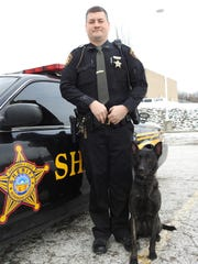 Deputy Josh Whiteman stands with Panzer, the newest K-9 at the Muskingum County Sheriff's Office.