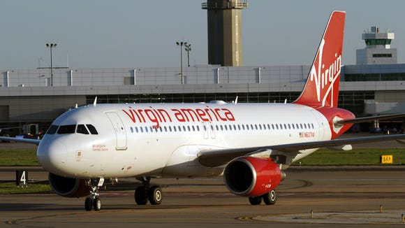 A Virgin America plane taxis into position at Dallas