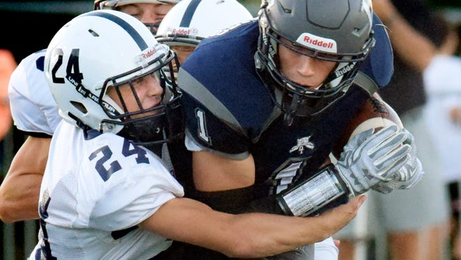 Dallastown's Jacob Jansen, right, the York-Adams League Division I Player of the Year, will be honored at the Quarterback Club of York banquet on Monday, Feb. 8.