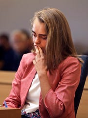 Defendant Michelle Carter listens as prosecutor Maryclare