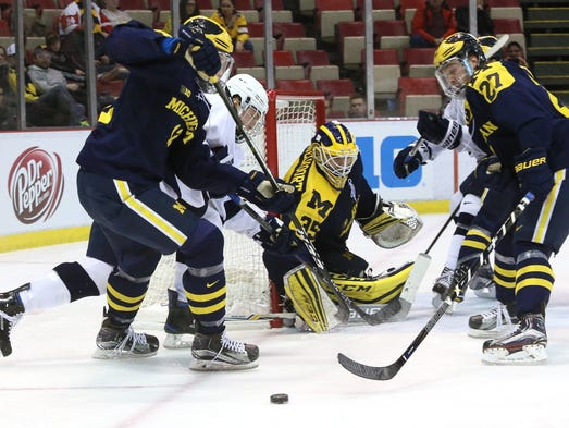 Michigan goalie Zach Nagelvoort keeps an eye on the