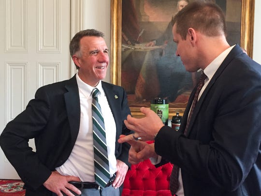 Gov. Phil Scott speaks with Tax Commissioner Kaj Samsom following a Thursday afternoon news conference at the Statehouse in Montpelier. The governor said lawmakers were wasting resources by approving budget and tax bills that he will veto.