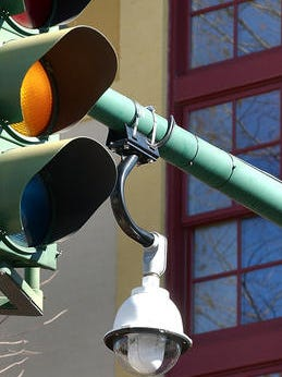 One of the cameras used for traffic and security purposes downtown hangs next to a street light  on Jefferson Street.
