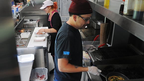Kirstie Chang, left, and Peter Chang, owners of the