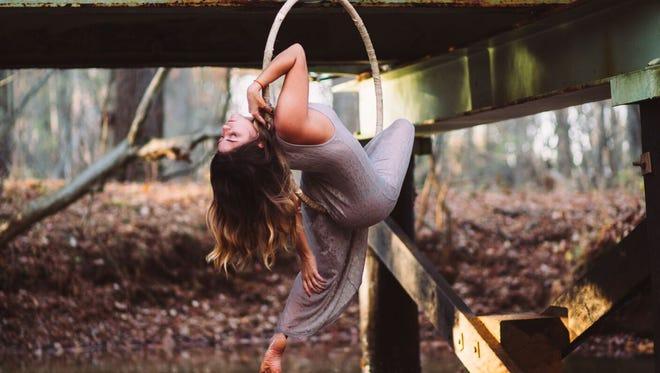 Megan Wilmot poses on an aerial hoop.