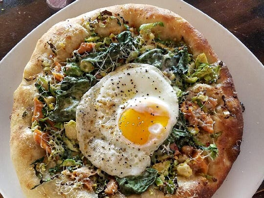 One of the pizzas at the new Camp Social restaurant will feature smoked trout, Brussels sprouts and a fried egg.