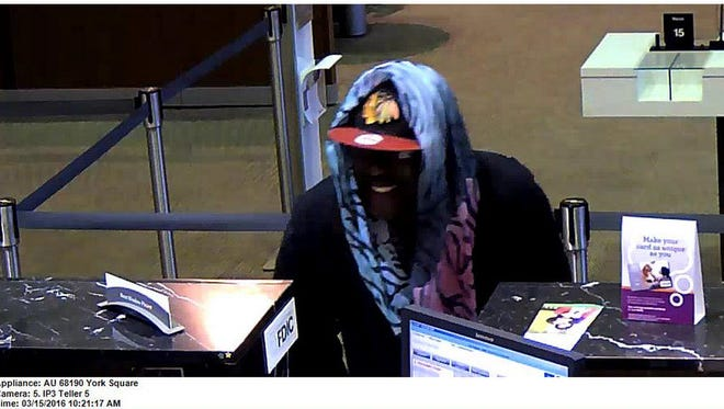 A man dressed as a woman robbed a York branch of the Wells Fargo Bank on Tuesday morning.