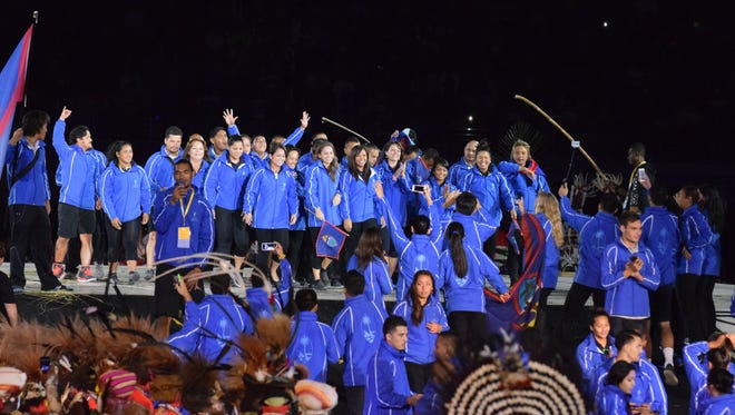 In this file photo, Team Guam on center stage at the 2015 Pacific Games opening ceremony. `