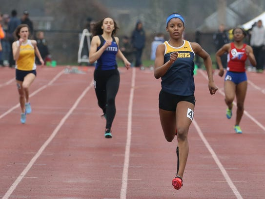 Vanessa Watson, Spencerport, center, runs away from