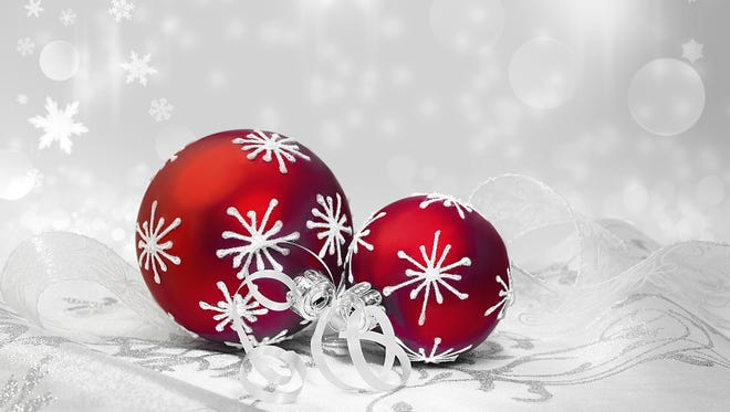 Red Christmas decorations on winter background, text space