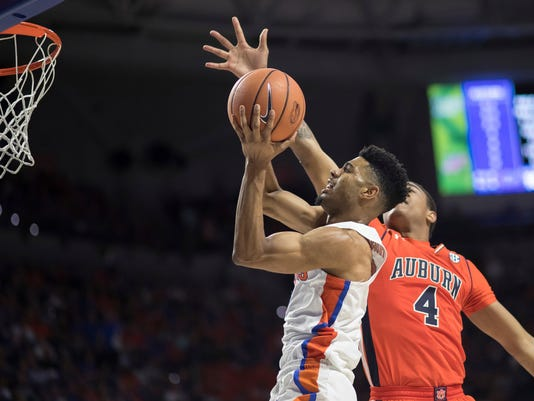 FILE - In this Feb. 24, 2018, file photo, Florida guard Jalen Hudson (3) shoots a layup next to Auburn forward Chuma Okeke (4) during the first half of an NCAA college basketball game in Gainesville, Fla. Hudson, the team's leading scorer this season, has declared for the NBA draft. Hudson made the announcement on his Instagram page Tuesday, March 27, saying he won't hire an agent at this time. Not doing so leaves open the possibility that Hudson could return for his senior season. )AP Photo/Ron Irby, File)