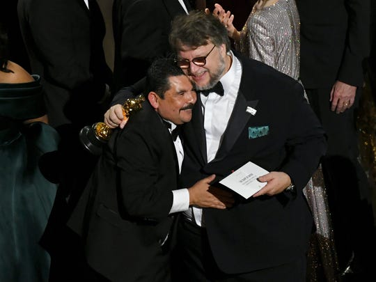 TV personality Guillermo Rodriguez (L) congratulates director Guillermo del Toro on winning Best Picture for 'The Shape of Water' onstage during the 90th Annual Academy Awards at the Dolby Theatre at Hollywood & Highland Center on March 4, 2018 in Hollywood, California.