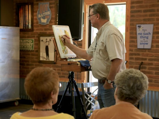 St. George artist Roland Lee gives a painting presentation