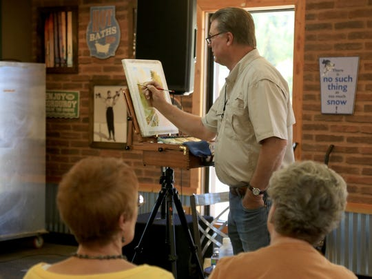 St. George artist Roland Lee gives a painting presentation at Brian Head during the Arts Afire Plein Air Event.