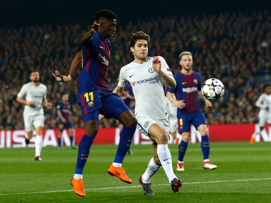 Barcelona's Ousmane Dembele, center left, vies for the ball with Chelsea's Marcos Alonso during the Champions League round of sixteen second leg soccer match between FC Barcelona and Chelsea at the Camp Nou stadium in Barcelona, Spain, Wednesday, March 14, 2018. (AP Photo/Manu Fernandez)