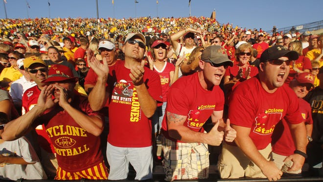 Iowa State fans cheer as the team leaves the field with the Cy-Hawk Trophy Saturday Sept. 8, 2012, at Kinnick Stadium in Iowa City, Iowa. ISU defeated Iowa 9-6(Rodney White/The Des Moines Register)