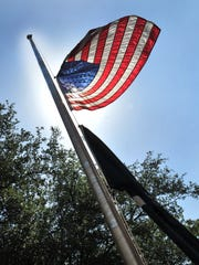 The American flag at the Wichita County Courthouse flew at half-staff, Tuesday after President Trump ordered the flags to be lowered to honor the five victims of the Capital Gazette newspaper shooting in Annapolis, MD.
