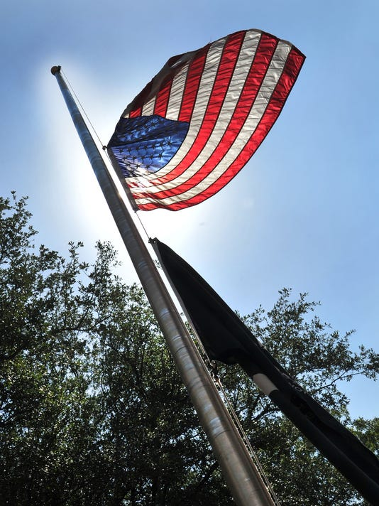 Flags lowered in honor of Gazette victims