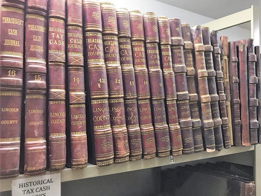 A row of historical tax books, which often note the