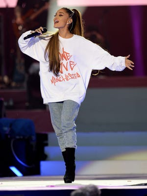 Ariana Grande owns the stage at the One Love Manchester tribute concert. Click forward to see who else performed and other sights at the event.