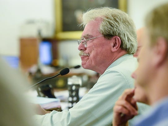 Sen. Mark MacDonald, D-Orange, listens as the Legislative