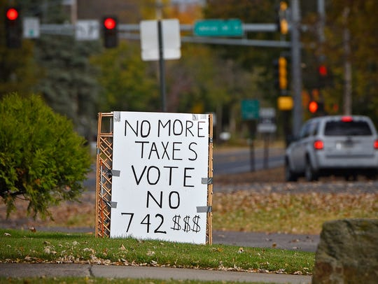 A yard sign along Clearwater Road in St. Cloud Tuesday
