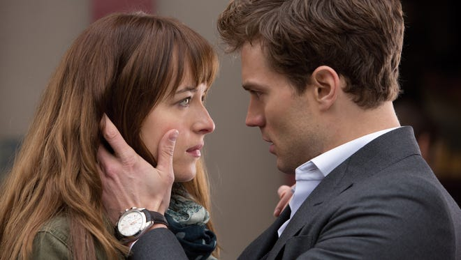"""Dakota Johnson as Anastasia Steele and Jamie Dorne as Christian Grey in a scene from the motion picture """"Fifty Shades of Grey."""" The movie promotes abuse and relational dysfunction, psychiatrist Miriam Grossman writes."""