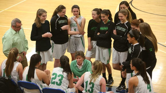 Current Irvington seniors Mary Brereton (second from left), Kelly Degnan (third from left), Heather Hall (fifth from left), and Olivia Valdes (sixth from left) listen in during a timeout in the Class B state regional championship game as freshmen. Mar. 13, 2015.