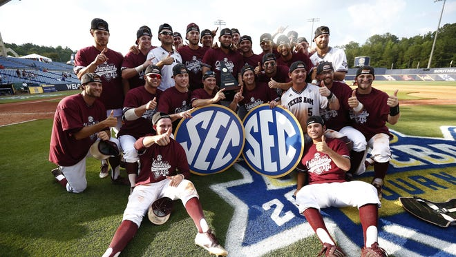 Texas A&M's players celebrate their win against Florida to clinch the SEC title.