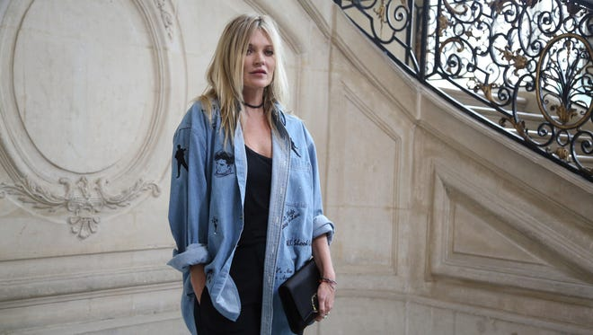 Kate Moss poses for photographers before the presentation of Christian Dior's Spring-Summer 2017 ready-to-wear fashion collection.