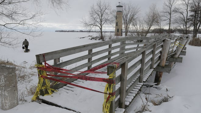 The bridge that connects Asylum Point Park and the Lighthouse is in need of repair. The ice has shoved against the pylons and has caused the bridge to shift making it unstable for crossing.