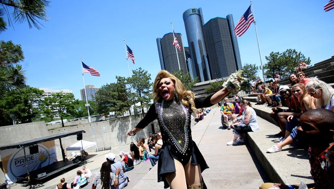 Victoria Sanchez of Ferndale, a drag queen performer, makes her way to the Pyramid Stage before the start of the Miss & Mr Motor City Pride Pageant at Hart Plaza on Saturday, June 10, 2017 in Detroit.