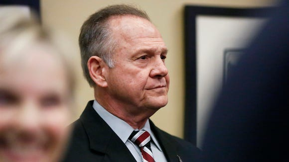Former Alabama Chief Justice and U.S. Senate candidate Roy Moore waits to speak the Vestavia Hills Public library, Saturday, Nov. 11, 2017, in Birmingham, Ala. According to a Thursday, Nov. 9 Washington Post story an Alabama woman said Moore made inappropriate advances and had sexual contact with her when she was 14. Moore is denying the allegations.