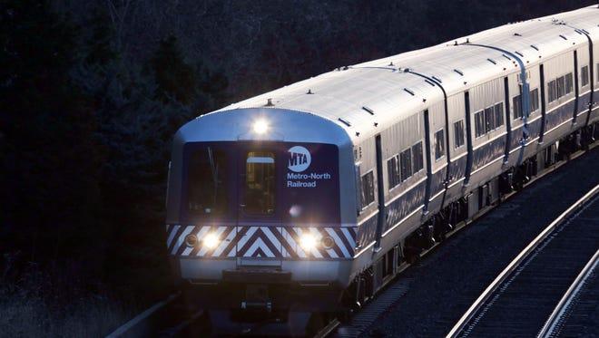A Metro-North passenger train travels north into Dobbs Ferry to New York City Dec. 21, 2017.
