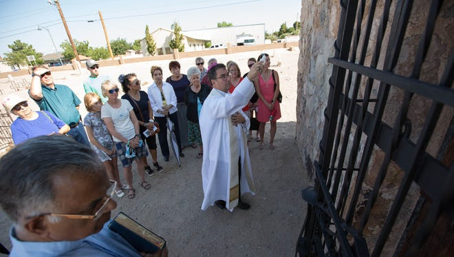 Bishop Oscar Cantu of the Catholic Diocese of Las Cruces, blesses the newly refurbished Amador Mausoleum in the San Jose Cemetery, as descendants of the Amador Family gathered to celebrate the completion of the restoration. Monday August 6, 2018.