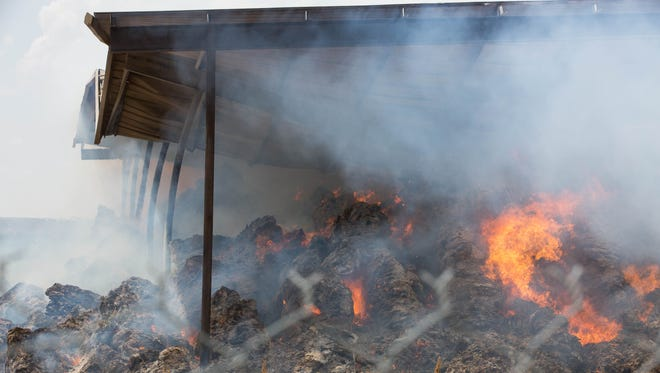A fire engulfs 800 tons of hay in a shed on Tuesday, Aug. 21, 2018 west of Landmark Mercantile, located near the Mesquite Exit of Interstate 10. The fire is burning up a shed and hay belonging to a family member of the mercantile's owners. The damage is valued at $250,000, according to county fire officials.