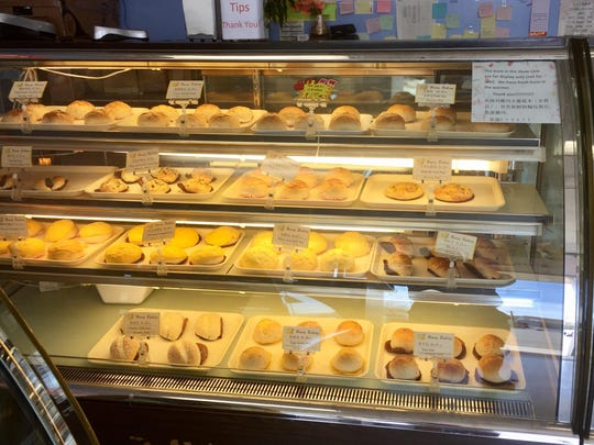 Cases are filled with buns and other baked goods at Honey Bakery, a Chinese bakery on Keystone Avenue.