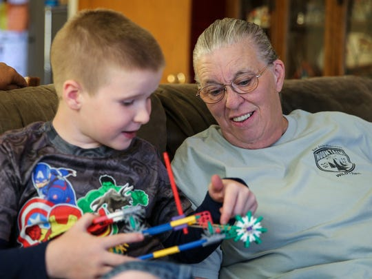 Daniel Jr. shows off a toy to his grandmother, Annie Harding.