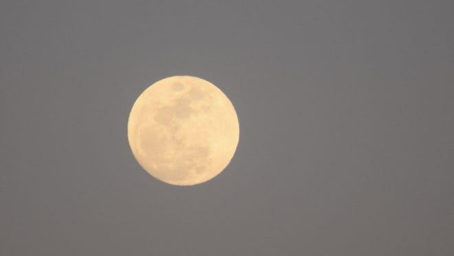 A full moon rises above the desert on Sunday, Feb. 21, 2016.