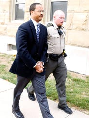 Patrick Edouard, former Pella preacher, left the Marion County Courthouse after being taken into custody by Marion County Sheriff Deputies after being sentenced to five years for sexual exploitation by a counselor in Knoxville in 2012.