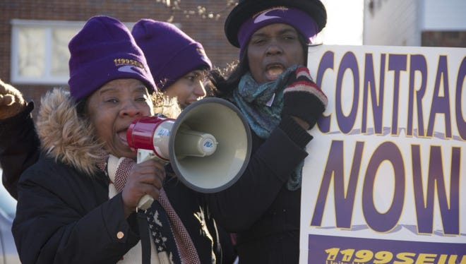 Some of the speakers during the 24-hour strike at the AristaCare at Delaire nursing home in Linden on Monday.