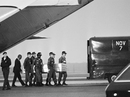 1978: Military pallbearers at Dover Air Force Base carry one of the bodies of the Jonestown, Guyana, mass suicide on Nov. 23, 1978.