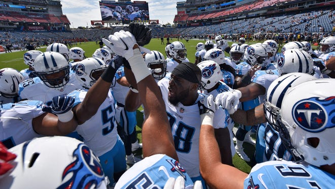 Titans outside linebacker Brian Orakpo (98) leads the team in a huddle before a preseason game against the Bears on Sunday, Aug. 27, 2017, at Nissan Stadium.