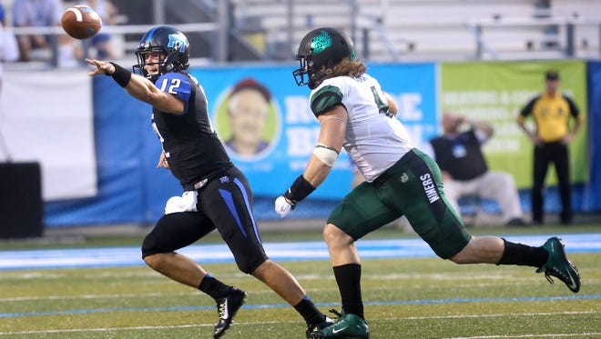MTSU's Brent Stockstill (12) has thrown nine touchdowns this season and will have to start fast against Illinois to pull off MTSU's first win against a Big Ten team.