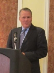 Richard Kolosky of Rhinebeck Bank speaks at Dutchess Outreach's recent benefit brunch, where the bank was one of the honorees.