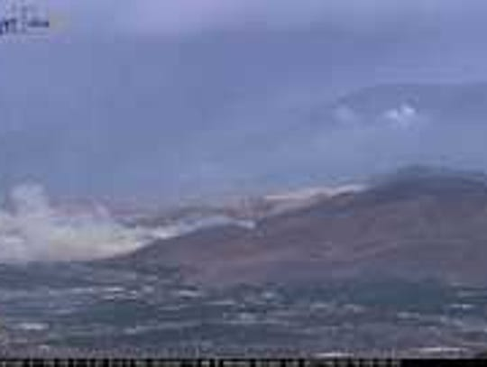 A fire burning in Carson City as seen from the McClellan