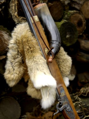 Muzzleloader with powder horn
